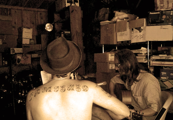 "Roosevelt & Ira Lee, recording ""There Go John"" in the barn"